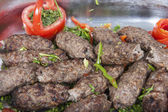 Grilled kofta meat at an oriental restaurant buffet — Stock Photo