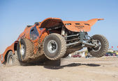 Off-road truck competing in a desert rally — Stock Photo