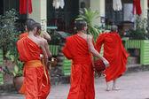 Monks in luang prabang — Stock Photo