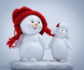 Cheerful snowman and penguin — Stock Photo