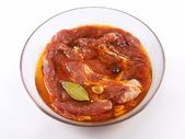Meat, Pork in marinade on a glass plate — Stock Photo