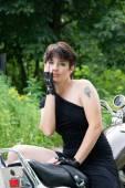 Young stylish girl and bike — Stock Photo