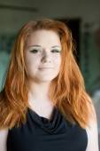 Portrait of a cute red-haired girl — Stock Photo