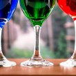 Glasses with blue red and green liquid cocktails — Stock Photo #52577359