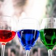 Glasses with blue red and green liquid cocktails — Stock Photo #52577379