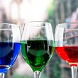 Glasses with blue red and green liquid cocktails — Stock Photo #52637565