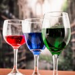 Glasses with blue red and green liquid cocktails — Stock Photo #52637619