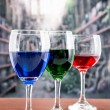 Glasses with blue red and green liquid cocktails — Stock Photo #53008233