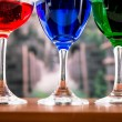 Glasses with blue red and green liquid cocktails — Stock Photo #53083575