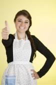 Beautiful young woman chef cook baker wearing apron — Stockfoto