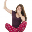 Pretty brunette teenage girl in pajamas pyjamas waking up — Stock Photo #53214249