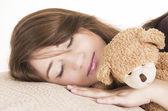 Beautiful young brunette girl sleeping — Stock Photo