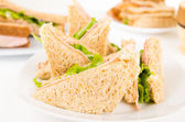 Ham and lettuce sandwich on a white plate — Stock Photo