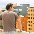 Young man looking at Quito city view from balcony — Stock Photo #53497801