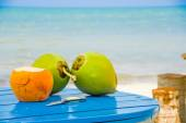 Coconuts on a table by the beach in livingston guatemala — Stock Photo
