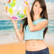 Beautiful young girl playing with beach ball — Stock Photo #54260397