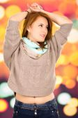 Portrait beautiful young blond girl over colorful background — Stock Photo