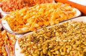 Pumpkin seeds and fried broad beans in market stand — Stock Photo