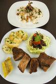 Fritada with mote con chicharron fried pork hominy toasted corn nuts Ecuadorian food — Stock Photo