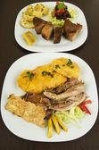 Hornado fritada roasted and fried pork ecuadorian traditional food — Stock Photo