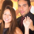 Happy latin young couple dancing in a nightclub — Stock Photo #57507471