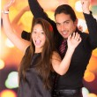 Happy latin young couple dancing in a nightclub — Stock Photo #57507313