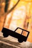 Cut out car silhouette over forest background — Stock Photo