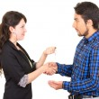 Young beautiful woman handing over key to man — Stock Photo #58326321