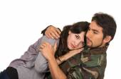 Young woman and soldier in military uniform say goodbye deployment — Stock Photo
