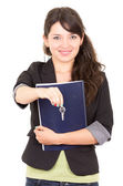 Portrait of beautiful woman real estate agent holding a key — ストック写真