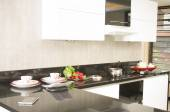 Beautiful black and white kitchen — Stock Photo