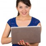 Beautiful latin young woman using laptop — Stock Photo #59063921
