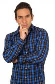 Young handsome man wearing a blue plaid shirt posing — Stock Photo