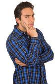 Guapa Latina joven llevando una camisa a cuadros azul posando — Foto de Stock