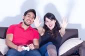 Young cute couple playing video games — Stock Photo