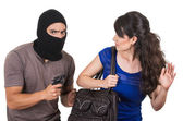 Male thief robbing beautiful young girl — Stock Photo