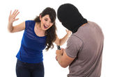 Male thief with gun ready to rob young girl — Stock Photo