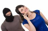 Masked male thief robbing beautiful young girl — Stock Photo