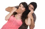 Male angry thief kidnapping holding young girl — Stock Photo