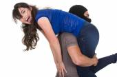 Male thief kidnapping carrying young girl — Stock Photo