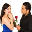Young beautiful girl receiving red rose from handsome man — Stock Photo #60692531