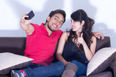 Attractive young couple taking a selfie — Stock Photo