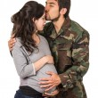 Happy proud military soldier hugging pregnant wife — Stock Photo #61204231
