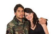 Young military soldier returns to meet his wife girlfriend — Stock Photo