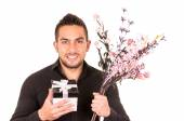 Handsome young man holding a flower bouquet — Foto Stock