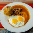Bolon de verde with fried egg and meat stew ecuadorian food — Stock Photo #61835589