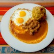 Bolon de verde with fried egg and meat stew ecuadorian food — Stock Photo #63385383