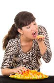 Young girl overeating junk food — Stock Photo
