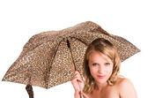 Closeup portrait of beautiful blond girl holding umbrella — Stock Photo