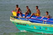 Unidentified young boys resting in an inflatable banana boat, Sua, Esmeraldas. — Stock Photo